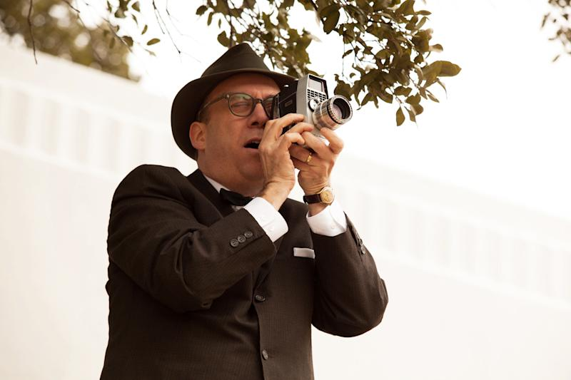 "This film image released by Exclusive Media Entertainment shows Paul Giamatti as Abraham Zapruder in a scene from ""Parkland."" Giamatti plays the unlikely documentarian in the new film ""Parkland,"" which arrives in theater's just before the 50th anniversary of the Nov. 22, 1963 assassination. The film recounts the chaotic events that occurred in and around the eponymous hospital after the president was brought there with hopes of saving his life. (AP Photo/ Exclusive Media Entertainment, Claire Folger)"