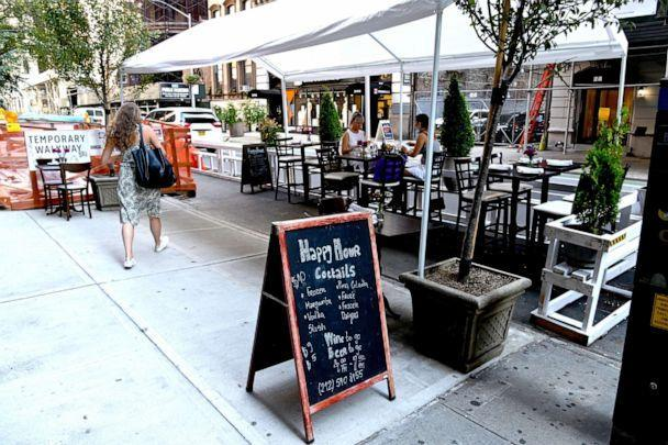 PHOTO: An outdoor dining area is seen as the city continues Phase 4 of re-opening following restrictions imposed to slow the spread of coronavirus, July 27, 2020, in New York City. (Jamie Mccarthy/Getty Images)