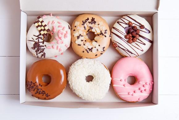 A box full of colorful donuts.