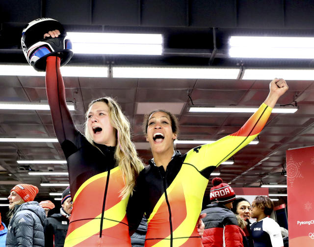 <p>Germany's Mariama Jamanka and Lisa Buckwitz celebrate after their gold medal winning run during the Women's Bobsled Final at the 2018 Winter Olympics in PyeongChang, South Korea, Wednesday, Feb. 21, 2018.<br>(AP Photo/Wong Maye-E) </p>