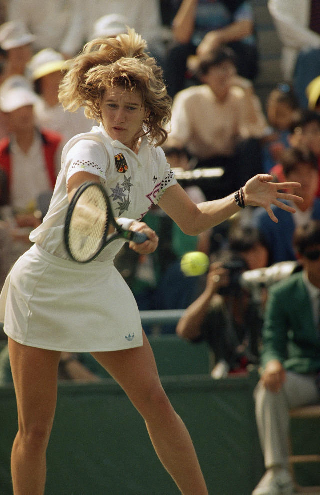 West Germany's Steffi Graf returns against Gabriela Sabatini of Argentina enroute to winning an Olympic gold medal in Seoul Saturday, October 1, 1988. Graf defeated Sabatini 6-3, 6-3. (AP Photo/Lionel Cironneau)