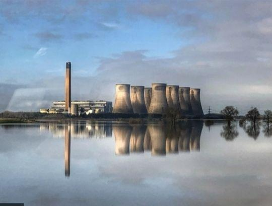<strong>Eggborough power station in North Yorkshire is reflected in floodwater from the River Aire.</strong> (Photo: PA Media)