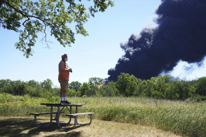 Neal Nuber, of South Beloit, Ill., watches the smoke billowing from a chemical plant fire in Rockton, Ill., Monday, June 14, 2021. (Stacey Wescott/Chicago Tribune via AP)