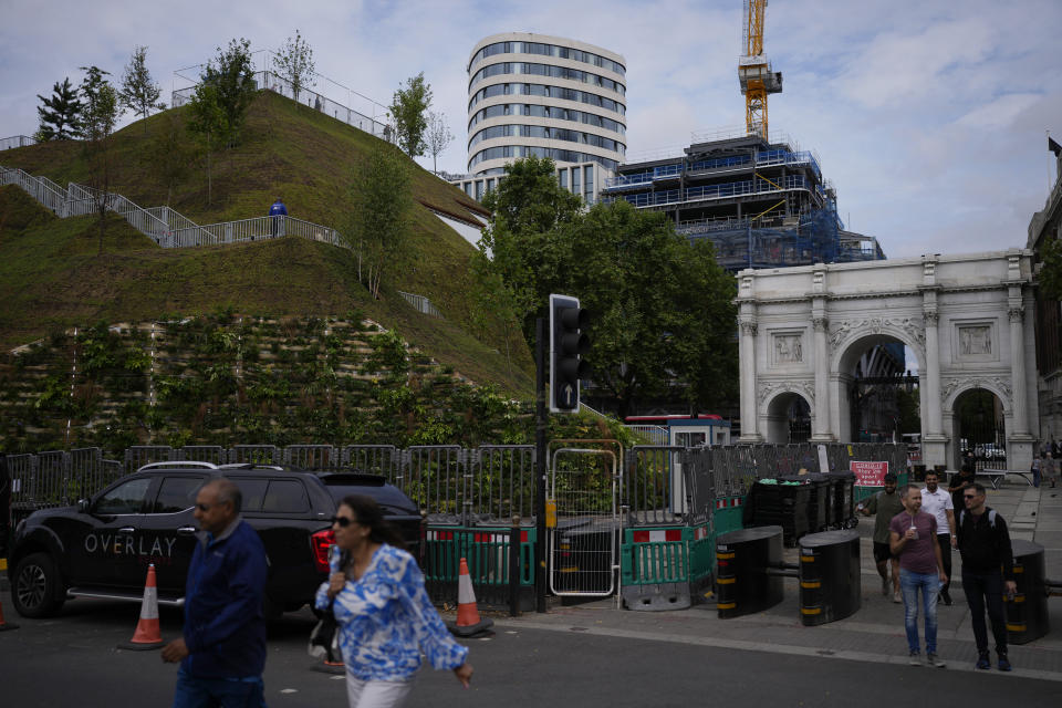 """A view of the newly built """"Marble Arch Mound"""" after it was opened to the public next to Marble Arch in London, Tuesday, July 27, 2021. The temporary installation commissioned by Westminster Council and designed by architects MVRDV has been opened as a visitor attraction to try and entice shoppers back to the adjacent Oxford Street after the coronavirus lockdowns. (AP Photo/Matt Dunham)"""