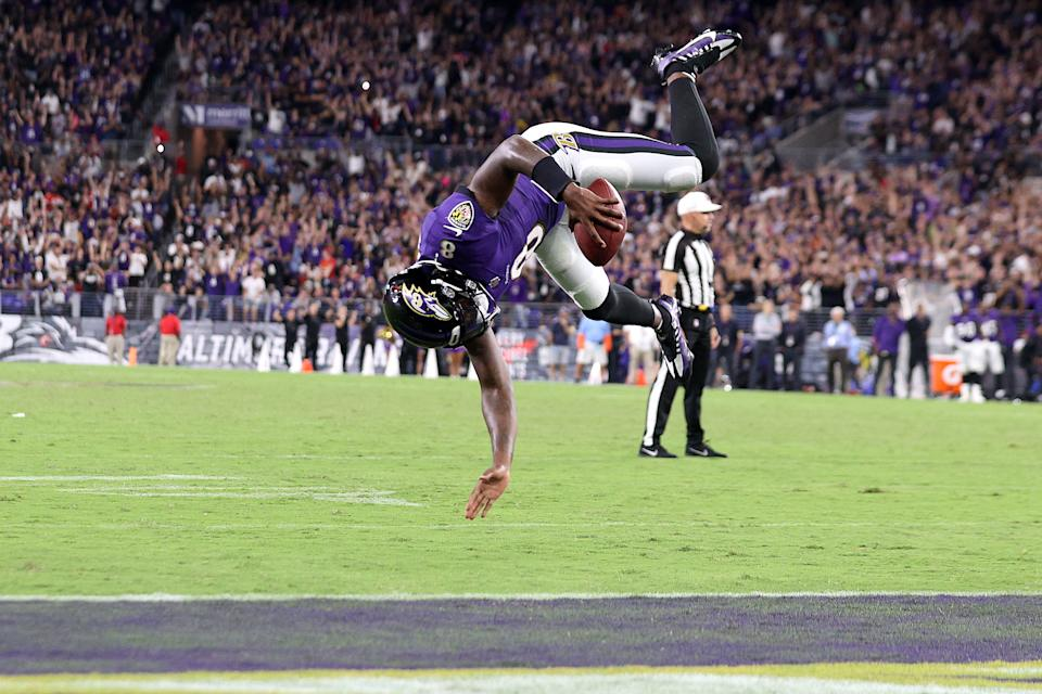 BALTIMORE, MARYLAND - SEPTEMBER 19: Lamar Jackson #8 of the Baltimore Ravens flips into the end zone for a touchdown against the Kansas City Chiefs during the fourth quarter at M&T Bank Stadium on September 19, 2021 in Baltimore, Maryland. (Photo by Rob Carr/Getty Images)