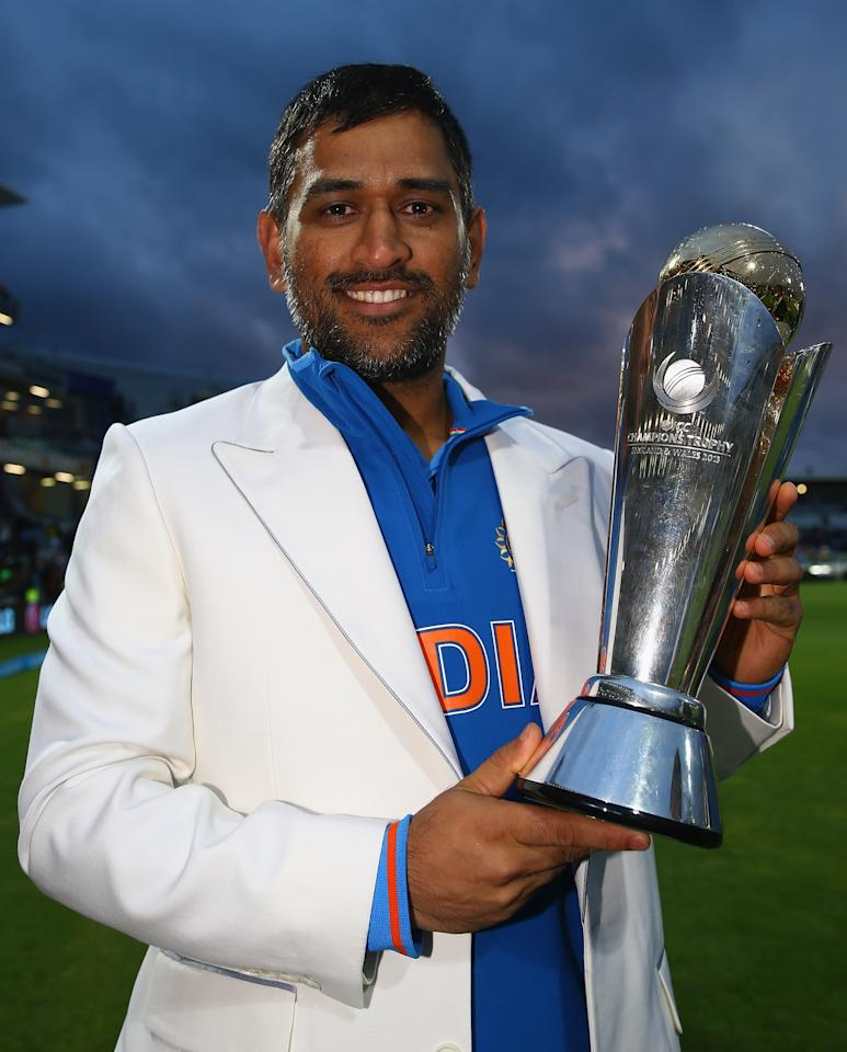 BIRMINGHAM, ENGLAND - JUNE 23:  MS Dhoni, Captain of India celebrates his teams win over England during the ICC Champions Trophy Final between England and India at Edgbaston on June 23, 2013 in Birmingham, England.  (Photo by Matthew Lewis-ICC/ICC via Getty Images)