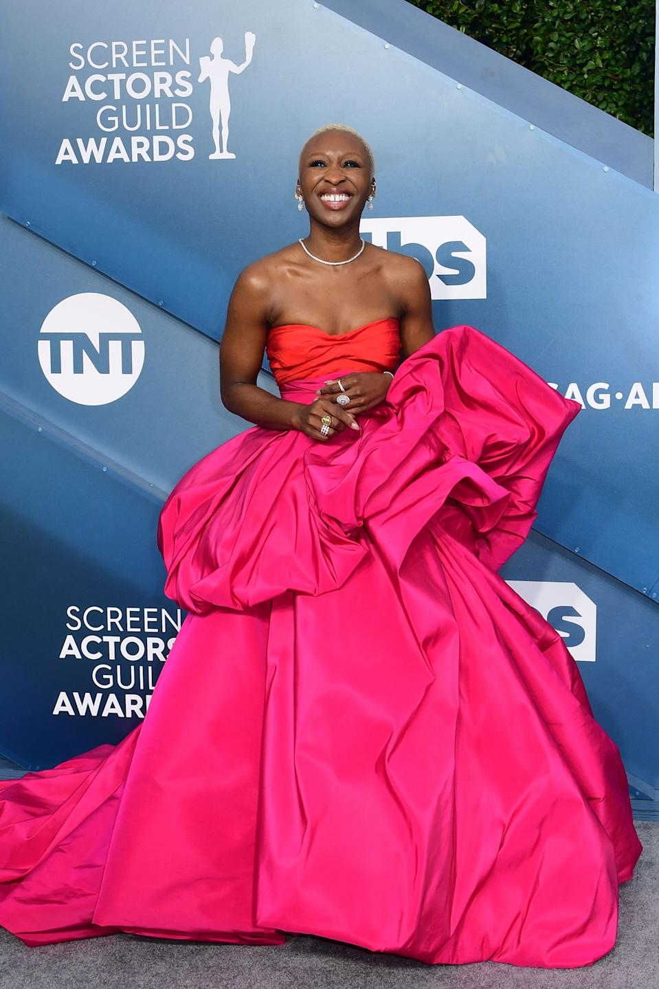 """""""Harriet"""" star Erivo and her Schiaparelli gown brought high-fashion drama to the carpet with a pink and red colour scheme."""