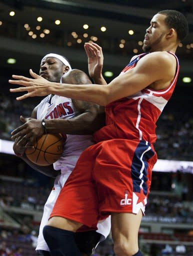 Detroit Pistons' Ben Wallace, left, grabs a rebound away from Washington Wizards' JaVale McGee in the first half of an NBA basketball game, Sunday, Feb. 12, 2012, in Auburn Hills, Mich. (AP Photo/Duane Burleson)