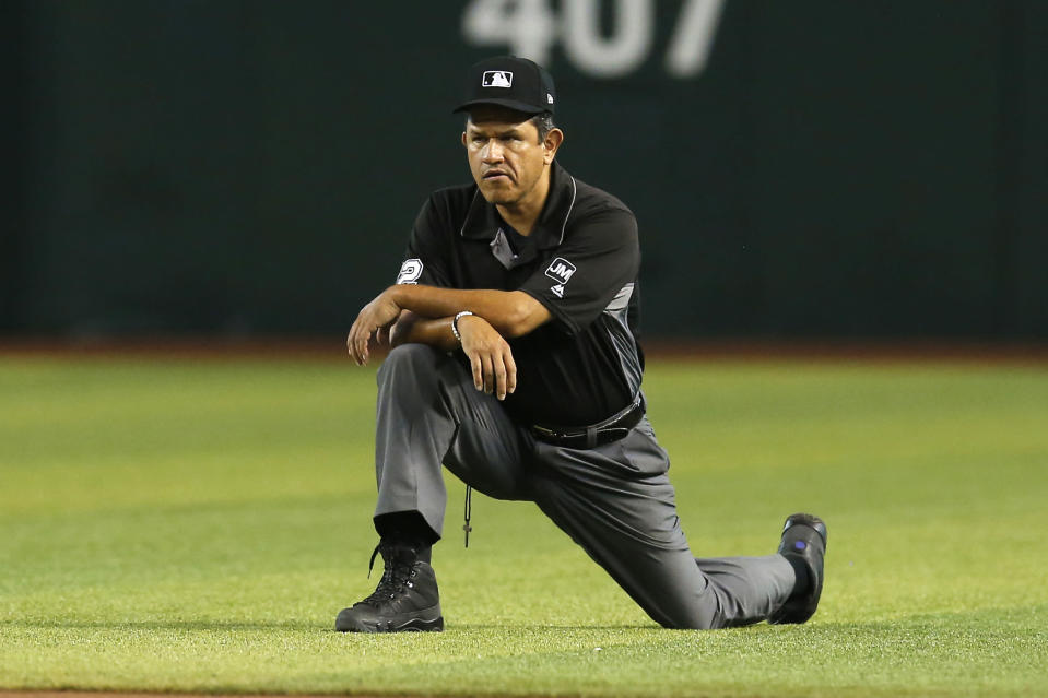 FILE - In this Aug. 8, 2019, file photo, Major League baseball umpire Alfonso Marquez is shown during the first inning of a baseball game between the Arizona Diamondbacks and the San Francisco Giants in Phoenix. Kerwin Danley became the first African American umpire crew chief in Major League Baseball during a series of retirements, promotions and additions announced Thursday, Feb. 27, 2020. The moves included Alfonso Marquez being elevated to the second Hispanic crew chief in MLB history. (AP Photo/Rick Scuteri, File)