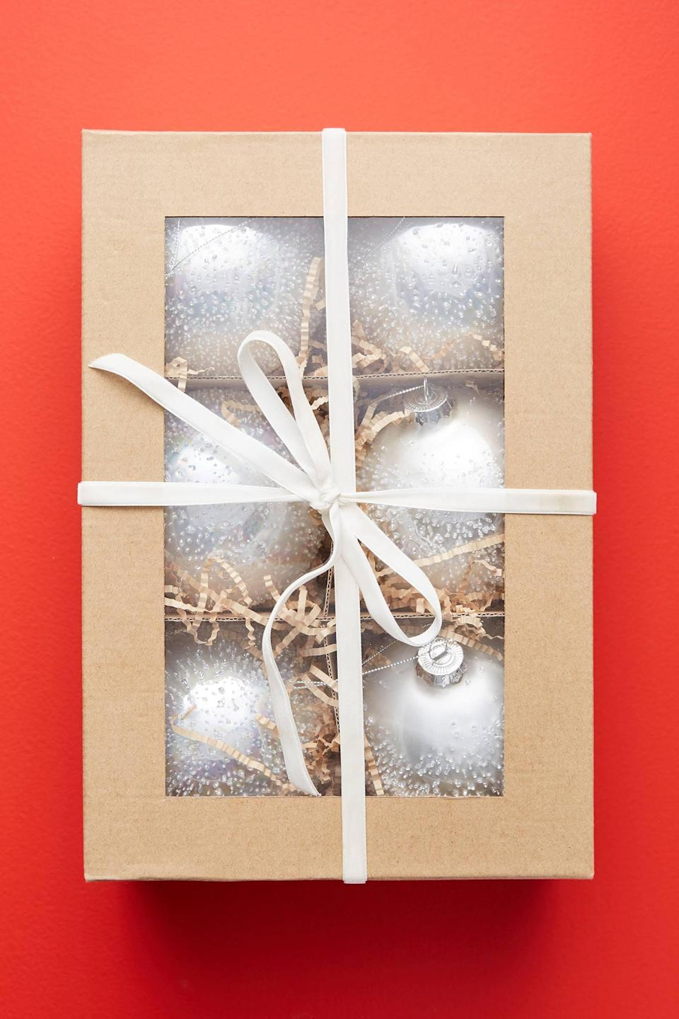 """<p>If you're doing an all-white tree, these <a href=""""https://www.popsugar.com/buy/Wintery-Ball-Ornaments-Set-Six-490586?p_name=Wintery%20Ball%20Ornaments%2C%20Set%20of%20Six&retailer=anthropologie.com&pid=490586&price=30&evar1=casa%3Aus&evar9=46615300&evar98=https%3A%2F%2Fwww.popsugar.com%2Fhome%2Fphoto-gallery%2F46615300%2Fimage%2F46615457%2FWintery-Ball-Ornaments-Set-Six&list1=shopping%2Canthropologie%2Choliday%2Cchristmas%2Cchristmas%20decorations%2Choliday%20decor%2Chome%20shopping&prop13=mobile&pdata=1"""" rel=""""nofollow noopener"""" class=""""link rapid-noclick-resp"""" target=""""_blank"""" data-ylk=""""slk:Wintery Ball Ornaments, Set of Six"""">Wintery Ball Ornaments, Set of Six</a> ($30) are perfect. </p>"""