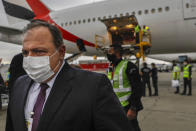 Brazil's Health Minister Eduardo Pazuello arrives to receive a container of vaccines against COVID-19 produced by Oxford/AstraZeneca that arrived from India at the international airport in Sao Paulo, Brazil, Friday, Jan. 22, 2021. (AP Photo/Marcelo Chello)