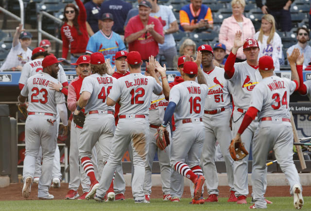 St. Louis Cardinals celebrate on the field after the Cardinals defeated the New York Mets 5-4 in 10 innings Friday, June 14, 2019, in New York in a game that was suspended Thursday because of rain. Paul DeJong (12) drove in Yairo Munoz, right, with the go-ahead run. (AP Photo/Kathy Willens)