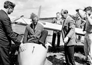 <p>Prince Philip climbs into the cockpit of a plane in 1957.</p>