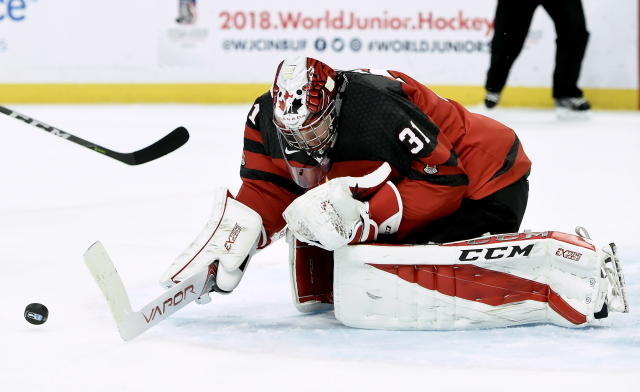 Winning games and superstition battles — all in a day's work for Team Canada goaltender Carter Hart. (Nathan Denette/The Canadian Press via AP)