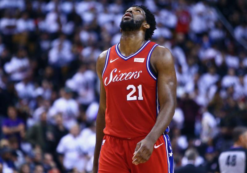 What possessed Joel Embiid to express his Packers love during a game against the Eagles? (Getty)