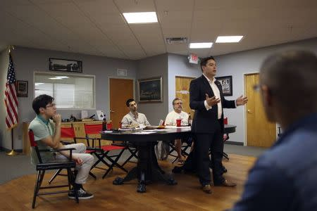 """So-called """"Liberty Kids"""" libertarian Republican activists listen to Art Alas, Republican candidate in the California 32rd Congressional District against Democrat Grace Napolitano, at a meeting in Burbank, California."""