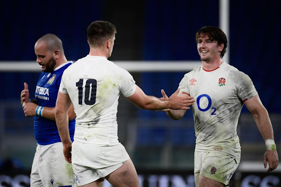 Owen Farrell congratulates Tom Curry after England beat Italy 34-5 (AFP via Getty)