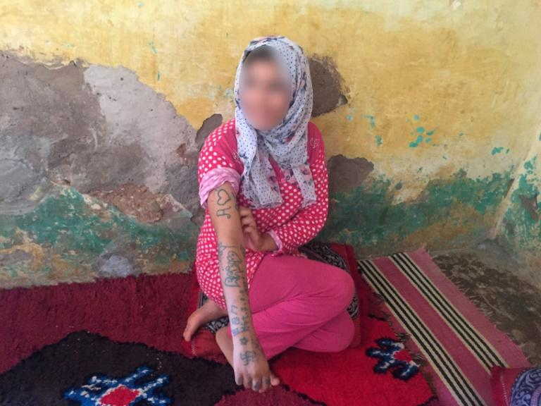 Teenager Khadija Okkarou, 17, is seen in a picture with her face blurred as she sits in her village in central Morocco