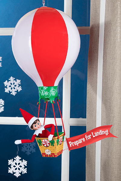 """<p>When Elves <em>don't</em> come in the front door, they arrive by air. (Naturally!) Construct a mini hot air balloon to make their arrival that much smoother.</p><p><strong>G</strong><strong>et the tutorial at <a href=""""https://www.elfontheshelf.com/blog/return-ideas"""" rel=""""nofollow noopener"""" target=""""_blank"""" data-ylk=""""slk:The Elf on the Shelf"""" class=""""link rapid-noclick-resp"""">The Elf on the Shelf</a>.</strong></p>"""