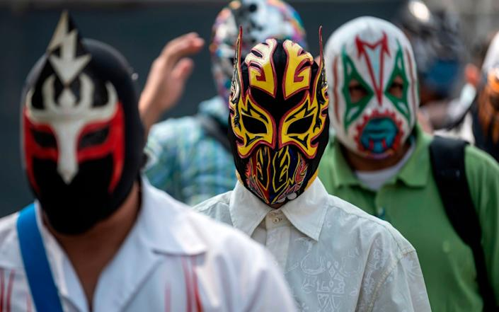 Mexican fighters wait in line in Mexico City - AFP
