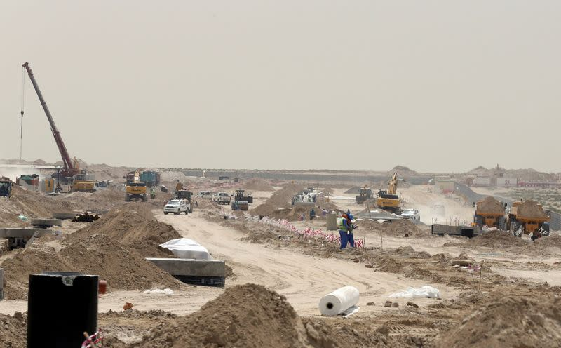FILE PHOTO: Labourers work at the construction site of Expo 2020 project in Dubai