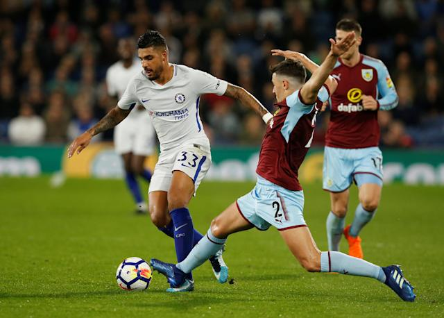 "Soccer Football - Premier League - Burnley vs Chelsea - Turf Moor, Burnley, Britain - April 19, 2018 Chelsea's Emerson Palmieri in action with Burnley's Matthew Lowton REUTERS/Andrew Yates EDITORIAL USE ONLY. No use with unauthorized audio, video, data, fixture lists, club/league logos or ""live"" services. Online in-match use limited to 75 images, no video emulation. No use in betting, games or single club/league/player publications. Please contact your account representative for further details."