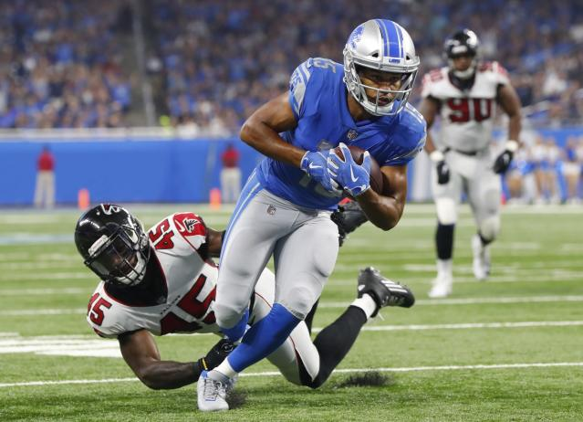 Detroit Lions wide receiver Golden Tate (15) was ruled down inches before scoring at the end of Sunday's loss to the Falcons. (AP)