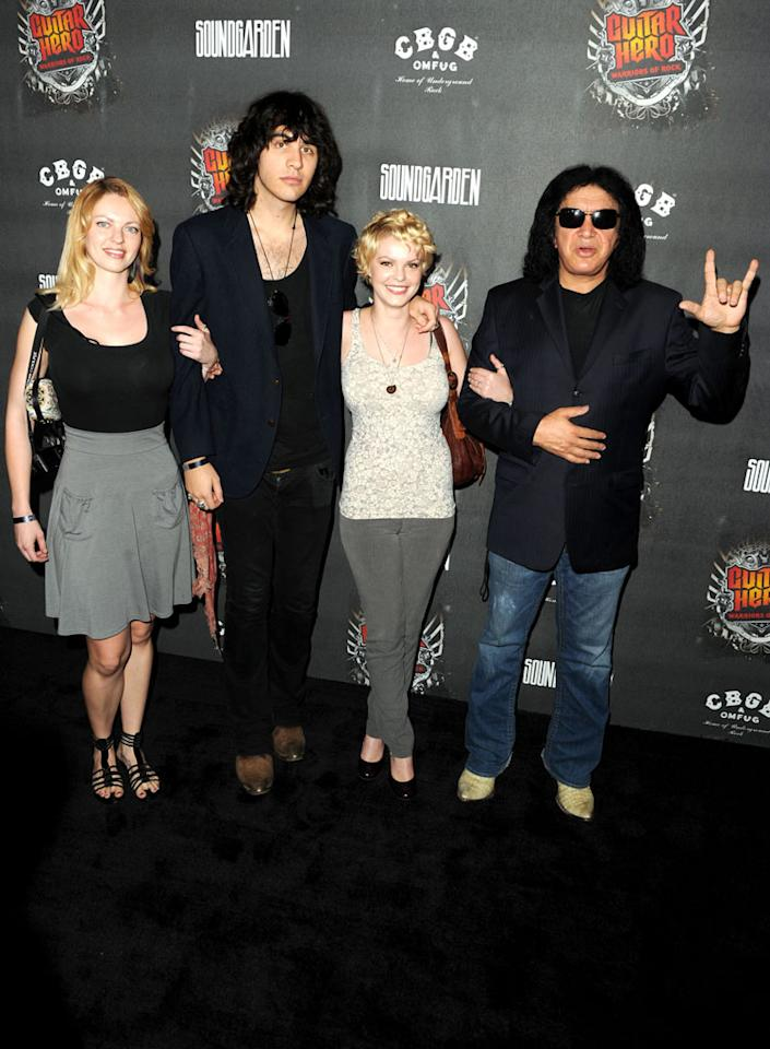 "Kiss front man-turned-reality star Gene Simmons -- who brought along his son, Nick, for the festivities -- lends his unmistakable voice to the new game which hit stores nationwide on Tuesday. Jason Merritt/<a href=""http://www.gettyimages.com/"" target=""new"">GettyImages.com</a> - September 27, 2010"