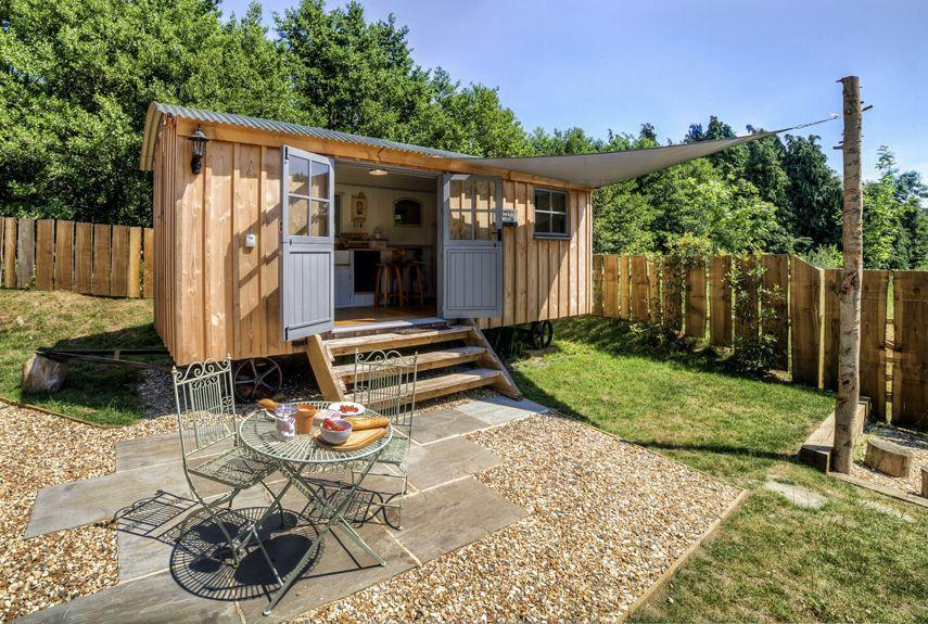 """<p>Surrounded by peaceful, bucolic farmland in Somerset, England, the <a href=""""http://www.theshepherdshutretreat.co.uk/"""" rel=""""nofollow noopener"""" target=""""_blank"""" data-ylk=""""slk:Shepherds Hut Retreat"""" class=""""link rapid-noclick-resp"""">Shepherds Hut Retreat</a> is comprised of four tiny """"huts"""" available for rent. Each structure overlooks a nearby pond, and includes its own private deck and fire pit. Inside the 20- by eight-foot huts, you'll find a fully functioning kitchen, a bathroom, a dining area, and a built-in bed. Rental rates start from around $243 per weekend.</p><p><a class=""""link rapid-noclick-resp"""" href=""""https://go.redirectingat.com?id=74968X1596630&url=https%3A%2F%2Fwww.tripadvisor.com%2FHotel_Review-g666345-d4859719-Reviews-The_Shepherds_Hut_Retreat-Crewkerne_Somerset_England.html&sref=https%3A%2F%2Fwww.countryliving.com%2Fhome-design%2Fg1887%2Ftiny-house%2F"""" rel=""""nofollow noopener"""" target=""""_blank"""" data-ylk=""""slk:PLAN YOUR TRIP"""">PLAN YOUR TRIP</a> <a class=""""link rapid-noclick-resp"""" href=""""http://www.theshepherdshutretreat.co.uk/the-huts/"""" rel=""""nofollow noopener"""" target=""""_blank"""" data-ylk=""""slk:SEE INSIDE"""">SEE INSIDE</a></p>"""