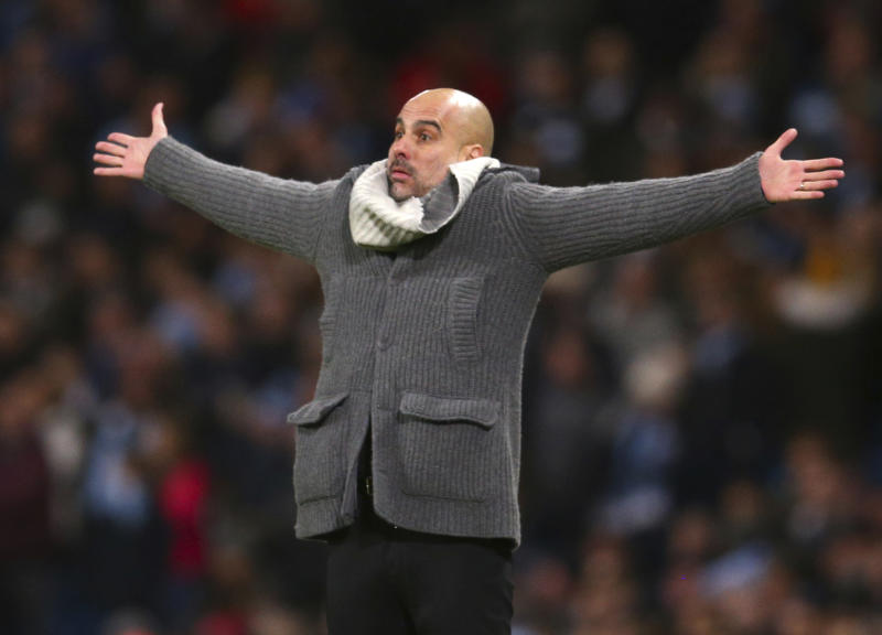 Manchester City coach Pep Guardiola reacts during the Champions League round of 16 second leg, soccer match between Manchester City and Schalke 04 at Etihad stadium in Manchester, England, Tuesday, March 12, 2019. (AP Photo/Dave Thompson)