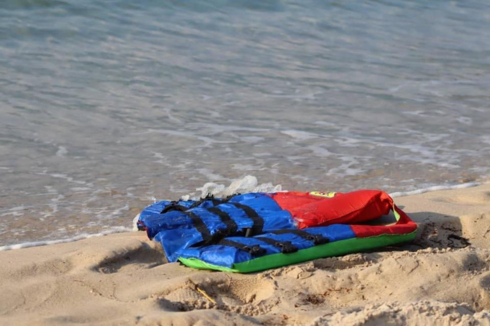 In these photos taken Nov. 12, 2020, life jackets litter the beach off the coast of Libya near the port of al-Khums. Several migrants drowned after their Europe-bound ship broke down off the coast of Libya on Thursday, the U.N. migration agency said, in the latest in a series of at least eight shipwrecks in the Central Mediterranean since last month. (Hussein Ben Mosa/ IOM 2020 via AP)