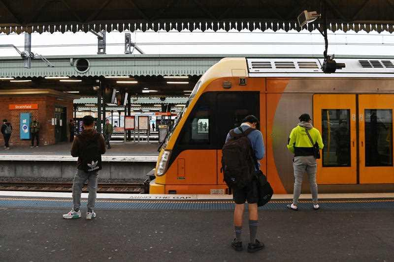 Commuters and school students return to public transport at Strathfield Train Station in Sydney.