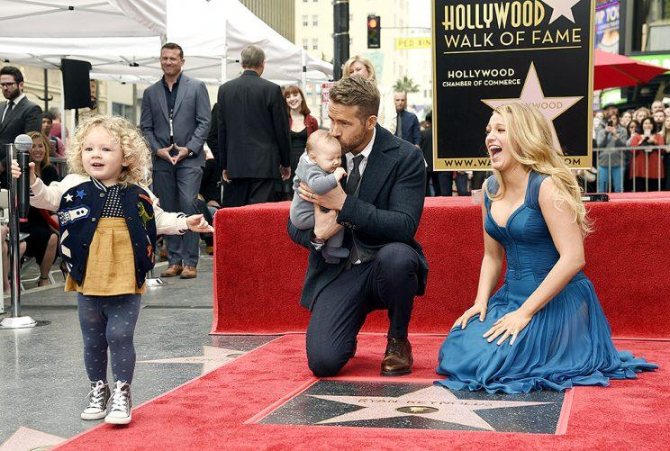Ryan Reynolds' daughter James, left, steals the microphone as Reynolds poses with his wife, actress Blake Lively, and their youngest daughter during a ceremony to award him a star on the Hollywood Walk of Fame on Thursday, Dec. 15, 2016, in Los Angeles (Photo: Chris Pizzello/Invision/AP)