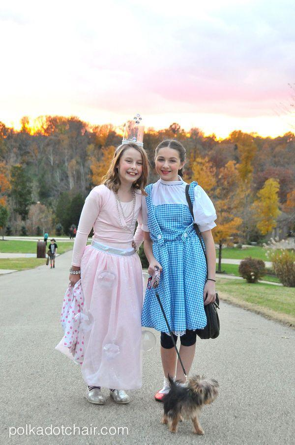 """<p>Iconic characters like the ones in <em><a href=""""https://www.countryliving.com/diy-crafts/g22105023/wizard-of-oz-diy-costumes/"""" rel=""""nofollow noopener"""" target=""""_blank"""" data-ylk=""""slk:The Wizard of Oz"""" class=""""link rapid-noclick-resp"""">The Wizard of Oz</a></em> work well on their own—but they're even better when coordinated with a friend.</p><p><strong>Get the tutorial at <a href=""""https://www.polkadotchair.com/diy-glinda-costume/"""" rel=""""nofollow noopener"""" target=""""_blank"""" data-ylk=""""slk:Polka Dot Chair"""" class=""""link rapid-noclick-resp"""">Polka Dot Chair</a>.</strong></p><p><a class=""""link rapid-noclick-resp"""" href=""""https://www.amazon.com/Elowel-Girls-Basics-Sleeve-Leotard/dp/B01LWP2PWQ?tag=syn-yahoo-20&ascsubtag=%5Bartid%7C10050.g.21349110%5Bsrc%7Cyahoo-us"""" rel=""""nofollow noopener"""" target=""""_blank"""" data-ylk=""""slk:SHOP PINK LEOTARD"""">SHOP PINK LEOTARD</a></p>"""