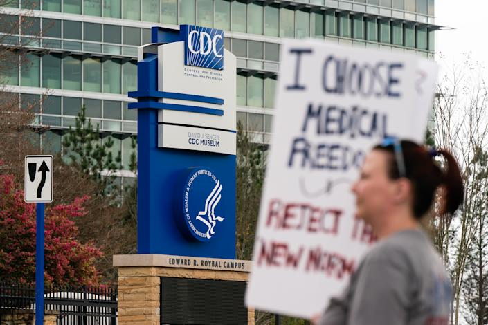 Protesters against masks, vaccines, and vaccine passports gather outside the headquarters of the Centers for Disease Control (CDC) in Atlanta in March.