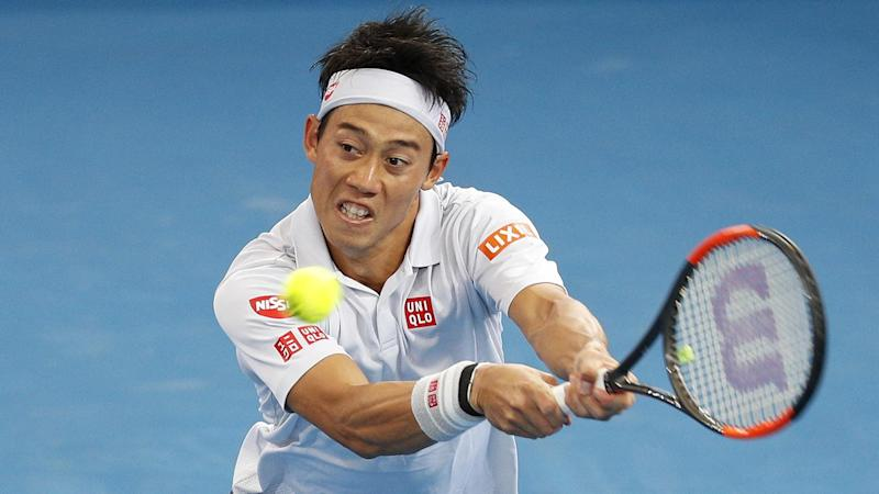 Kei Nishikori has survived a scare, outlasting Jared Donaldson in the Brisbane International.