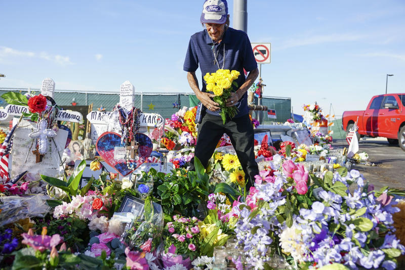 EL PASO, TX - AUGUST 16: Antonio Basco, who's wife Margie Reckard was one of 22 persons killed by a gunman at a local Walmart, lays flowers in her honor at a makeshift memorial near the scene on August 16, 2019 in El Paso, Texas. Basco has been to the memorial everyday site since it was erected to clean up the area and put out fresh flowers. 22 people were killed in Walmart during a mass shooting on August 3rd. A 21-year-old white male suspect remains in custody in El Paso which sits along the U.S.-Mexico border. (Photo by Sandy Huffaker/Getty Images)