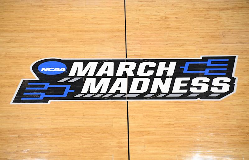 March Madness logo at mid court.