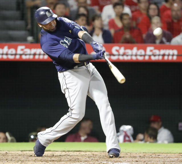 Seattle Mariners' Nelson Cruz watches his three-run home run in the fourth inning of a baseball game against the Los Angeles Angels in Anaheim, Calif., Thursday, Sept. 13, 2018. (AP Photo/Chris Carlson)