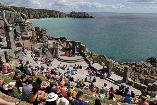 An audience enjoys the Sea Show performance at the Minack Theatre in Porthcurno near Lands End, on August 3