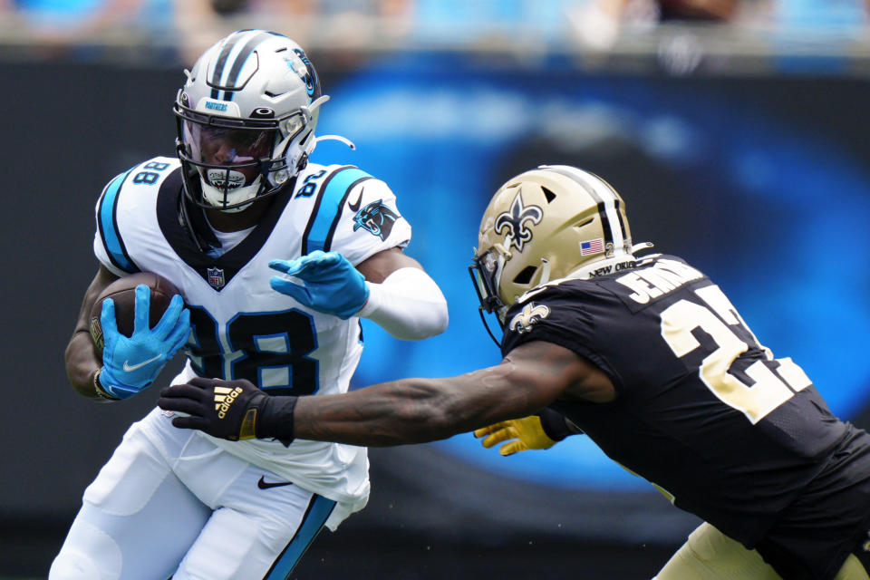 Carolina Panthers wide receiver Terrace Marshall Jr. is tackled by New Orleans Saints strong safety Malcolm Jenkins during the first half of an NFL football game Sunday, Sept. 19, 2021, in Charlotte, N.C. (AP Photo/Jacob Kupferman)