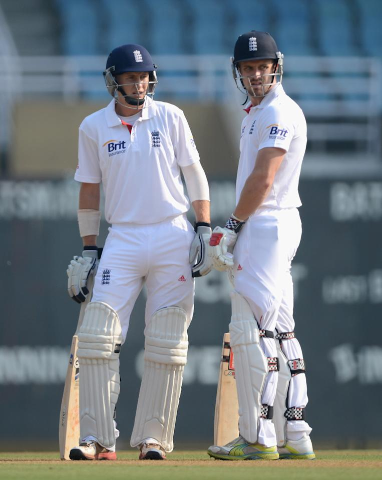 MUMBAI, INDIA - NOVEMBER 03:  Joe Root of England talks with opening partner Nick Compton during day one of the tour match between Mumbai A and England at The Dr D.Y. Palit Sports Stadium on November 3, 2012 in Mumbai, India.  (Photo by Gareth Copley/Getty Images)