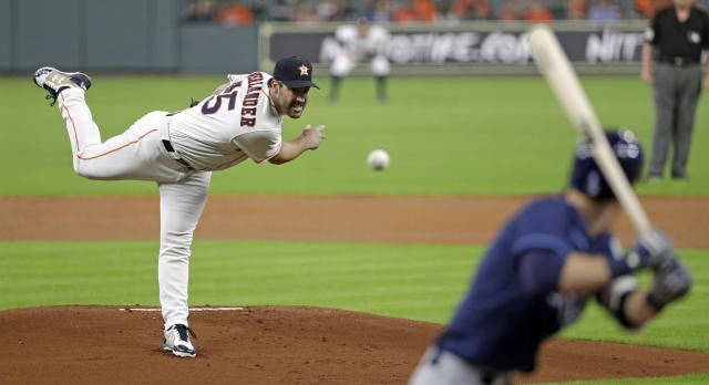 Houston Astros starting pitcher Justin Verlander, left, throws to Tampa Bay Rays' Matt Duffy during the first inning of a baseball game Tuesday, June 19, 2018, in Houston. (AP Photo/David J. Phillip)
