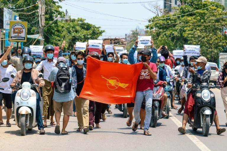 Protesters hold the Myanmar Student Union flag during a demonstration against the military coup in Mandalay