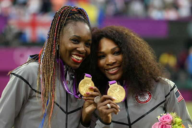 LONDON, ENGLAND - AUGUST 05: Gold medalists Serena Williams of the United States and Venus Williams of the United States celebrate during the medal ceremony for the Women's Doubles Tennis on Day 9 of the London 2012 Olympic Games at the All England Lawn Tennis and Croquet Club on August 5, 2012 in London, England. (Photo by Clive Brunskill/Getty Images)