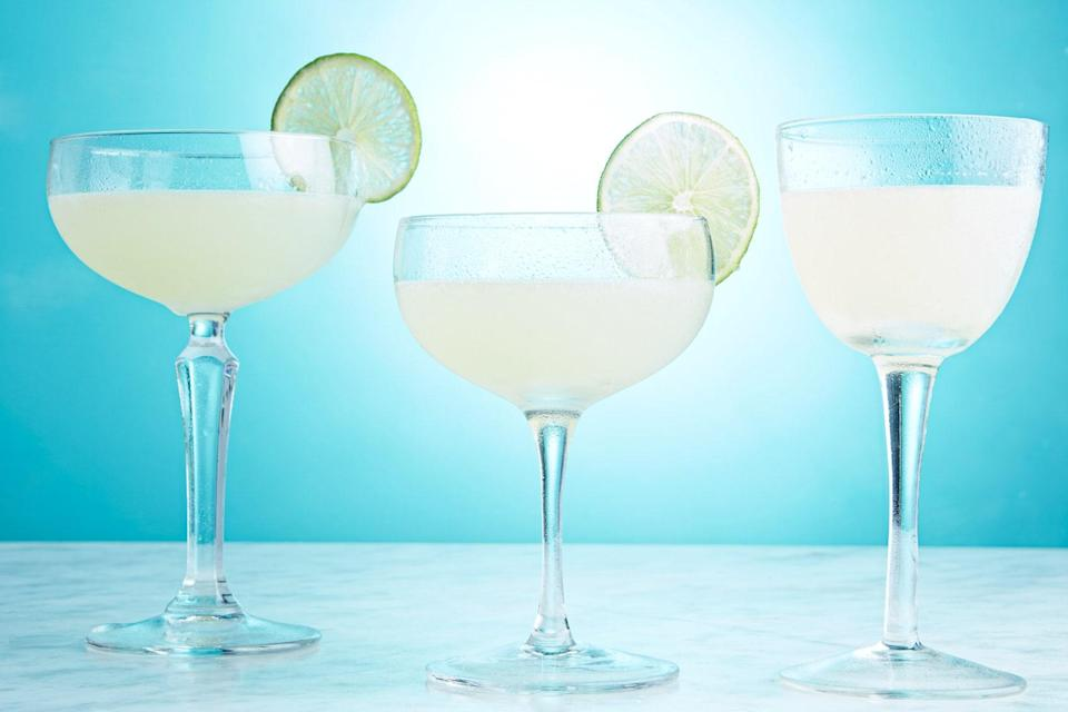 """The best daiquiris aren't found from a slushie machine on spring break. Using just three ingredients (and some upper arm strength), you can make your own—and make them amazing. <a href=""""https://www.epicurious.com/recipes/food/views/classic-daiquiri-235570?mbid=synd_yahoo_rss"""" rel=""""nofollow noopener"""" target=""""_blank"""" data-ylk=""""slk:See recipe."""" class=""""link rapid-noclick-resp"""">See recipe.</a>"""