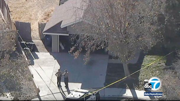 PHOTO: First responders stand in front of the home where the bodies of 2 children were found in Lancaster, Calif., Dec. 5, 2020. (KABC)