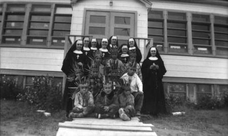 Sisters from the Soeurs du Sacre-Coeur d'Ottawa pose with students at the Pukatawagan Residential School, in Pukatawagan, Manitoba in a 1960 archive photo. REUTERS/Sister Liliane/Library and Archives Canada/PA-195120/handout