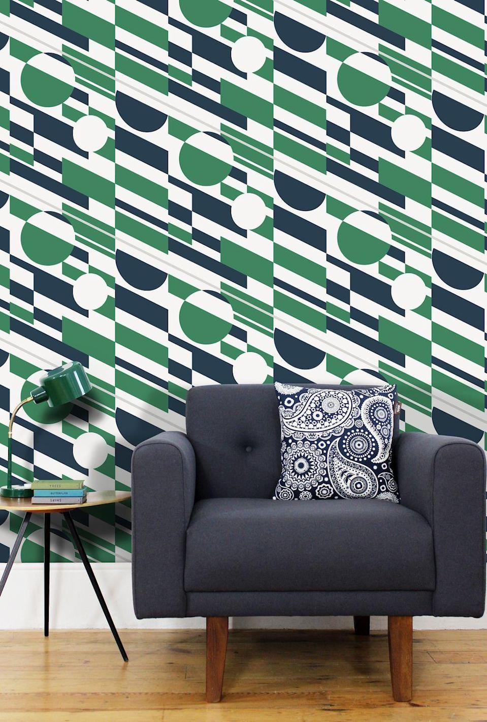 """<p>If mid-century is your thing, choose one of the stunning styles from Mini Moderns – this one is called <a href=""""https://www.minimoderns.com/product/p-l-u-t-o-wallpaper-coach-emerald-silver"""" rel=""""nofollow noopener"""" target=""""_blank"""" data-ylk=""""slk:P.L.U.T.O in Emerald and Silver"""" class=""""link rapid-noclick-resp"""">P.L.U.T.O in Emerald and Silver</a>. With bold stripes and circles, this wallpaper is named after the Pipeline Under The Ocean – a WW2 fuel line built under the English Channel from Britain to France. It's eco too, printed using water based ink on papers from sustained forests. </p>"""