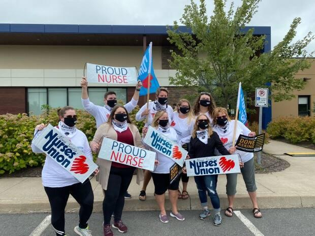 NSNU members rallied in front of the union's headquarters in Halifax on Friday morning. (Dave Laughlin/CBC - image credit)
